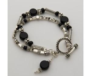 B132          Silver & Black Wrist
